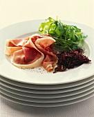 Prosciutto e confit di cipolle (Ham and onion confit)