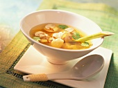 Clear broth with mushrooms and salmon dumplings