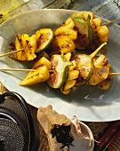Fried fig and pineapple kebabs; teapot and tea leaves