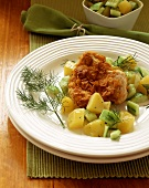 Turkey escalope in crispy coating with potatoes & cucumber