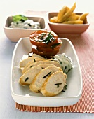 Chicken breast with olive dip, tomatoes and potato wedges