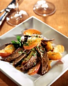 Strips of duck breast with peaches