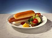Hot dog with ketchup, mustard and salad garnish