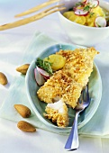 Redfish fillet in almond panade with potato and herb salad