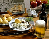 Matje herring fillet with apples, onions & potatoes; beer