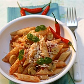 Penne all' arrabiata with chili peppers and mushrooms