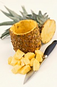 Hollowed-out pineapple and pineapple chunks