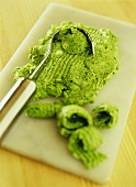 Herb butter with butter knife