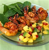 Shrimp kebab with spinach and pineapple and avocado salsa