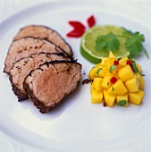 Pork fillet with mango and coriander salsa