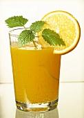 Glass of orange juice with mint