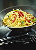 Spaghetti aglio e olio with tomatoes and basil