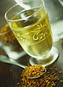 Saffron tea in glass; saffron on spoon