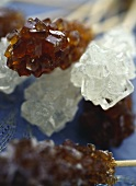 White and brown sugar crystals