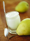 Jar of yoghurt and fresh pears