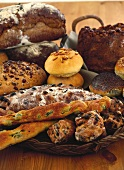Assorted bread and rolls, some with fruit