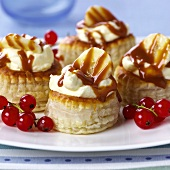 Sweet puff pastries with banana cream and caramel sauce