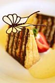 Piece of Japanese chocolate cake with butterfly