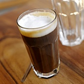 Frothy coffee in glass