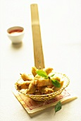 Spring rolls on slotted spoon