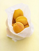Apricots in paper bag