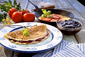 Crepe with blackberry jelly and with tomato and basil