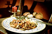 Mushroom ragout with tomatoes and ribbon pasta; bread; candle