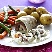 Plaice rolls with spinach and Parma ham