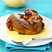 Bread pudding with candied fruits and custard