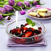 Berry salad with cream and mint