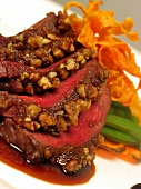 Venison steaks with date & pecan crust & sweet potato crisps
