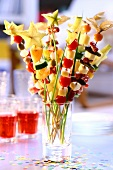 Colourful kebabs with vegetables, cheese and fruit