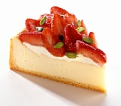 Piece of strawberry gateau with pistachios