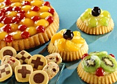 Fruit gateau, fruit tartlets and biscuits