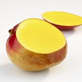 Fresh mango, a piece cut off