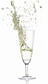 Prosecco splashing out of glass