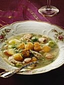 'Schnippel' soup with meat and croutons