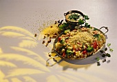 Couscous with vegetables and herb yoghurt sauce