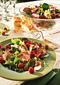 Iceberg lettuce with chicken fillet and raspberries
