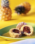 Semolina dumplings with gianduja filling on pineapple puree