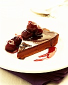 Piece of chocolate cake with cherries and cherry liqueur