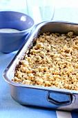 Apple crumble in baking dish