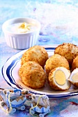 Boiled eggs in coconut panade