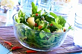 Dandelion salad with apples and chillies