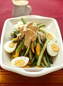 Asparagus and bean salad with mango, egg and curry dressing