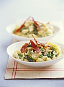 Pasta shells with peas and prosciutto