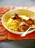 Chicken legs with curried rice