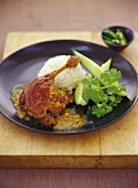 Duck leg with rice and wedges of lime