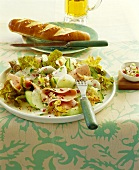 Sausage salad with radish and cucumber; pretzels; beer