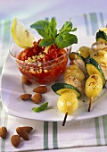 Potato and turkey kebabs with pepper and almond dip